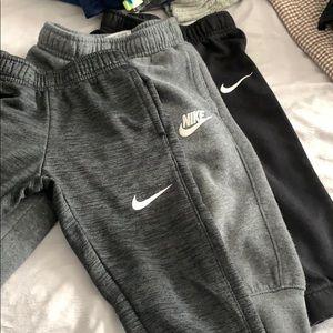 3 pairs of Nike sweatpants.